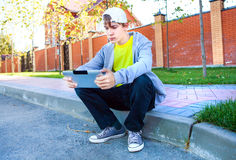 Sad Teenager with Tablet Computer. On the Street royalty free stock image