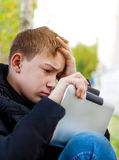 Sad Teenager with Tablet Royalty Free Stock Image