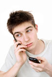 Sad teenager with two phones Royalty Free Stock Image