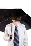 Sad Teenager with Umbrella. Sad Young Man with Umbrella Isolated on the White Background stock images