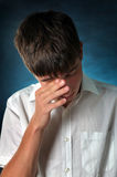 Sad Teenager Weeping. Sorrowful Teenager is Weeping on the Dark Background stock images