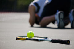 Sad tennis player after defeat Royalty Free Stock Images
