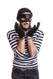 Sad thief with handcuffs. Portrait isolated on white background Royalty Free Stock Photography