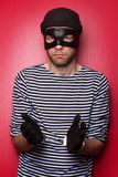 Sad thief with handcuffs Stock Image