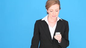 Sad Thoughtful Businesswoman With Mobile Phone. Sad thoughtful businesswoman looking away after concluding a conversation on her mobile phone stock video