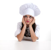 Sad, thoughtful female cook Stock Photo