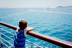 Sad thoughtful little boy looking at the sea Royalty Free Stock Photo