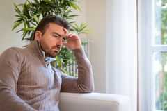 Sad and thoughtful portrait of man alone at home royalty free stock photos