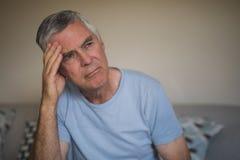 Sad thoughtful senior man at home Royalty Free Stock Images