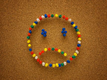 Sad thumbtack smiley face Stock Photos
