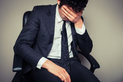 Sad and tired businessman stock photography