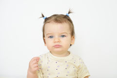 Sad tired child. Little newborn baby girl. Royalty Free Stock Photo