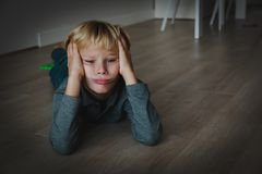 Sad tired child stress and depression, overload, anxiety. At home royalty free stock photos