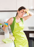 Sad tired housewife cleaning furniture Stock Photos