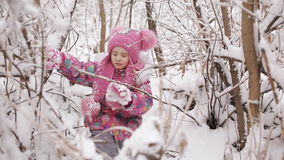 Sad and tired little girl got lost in the snowy forest. Little girl calls for help in a snowy forest stock video footage