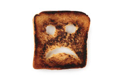 Sad toast. Isolated on white background Stock Photos