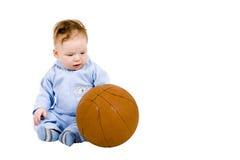 Sad toddler with basketball ball stock images