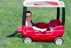 Sad toddler boy in wagon Stock Photo