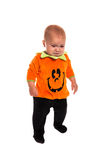 Sad Toddler dressed as a pumpkin for Halloween Stock Photos