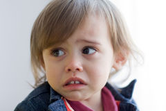 Sad toddler girl looks afraid Royalty Free Stock Photos
