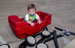 Sad Toddler and wagon, Assembly required Stock Photo