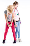 Sad trendy girls. Two teenage standing sad trendy girls Stock Photos