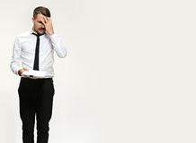 The troubled businessman. The sad and troubled business man on white background Stock Photo