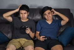 Sad two man playing video games and loses royalty free stock photo