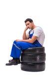 The sad tyre repairman isolated on white Stock Image