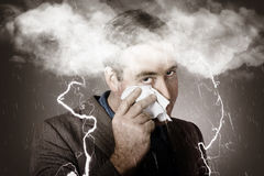 Sad and unhappy businessman crying a head storm Stock Image