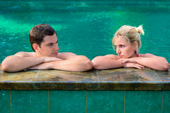 Sad and unhappy couple in swimming pool Royalty Free Stock Photo
