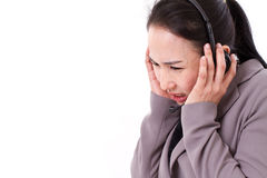 Sad, unhappy customer service staff with headset Royalty Free Stock Image