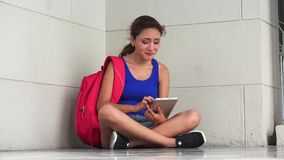 Sad Unhappy Female College Student With Tablet