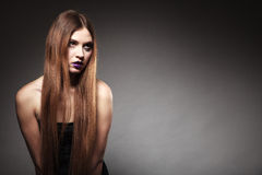 Sad unhappy girl with long hair creative makeup Stock Photos