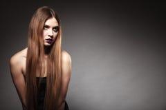 Sad unhappy girl with long hair creative makeup Stock Photos
