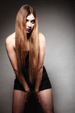 Sad unhappy girl young woman with long hair and creative makeup Royalty Free Stock Images