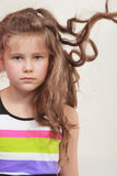 Sad unhappy little girl kid portrait. Stock Image