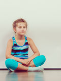Sad unhappy little girl kid in studio. Stock Image