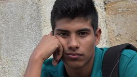 Sad And Unhappy Male Hispanic Teen. Photo of Sad And Unhappy Male Hispanic Teen Stock Photography