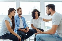 Sad unhappy people sharing their friends problems royalty free stock photography