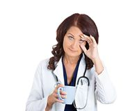 Sad unhappy sleepy female health care professional Stock Photo