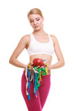 Sad unhappy woman holding apple and tape measures. Royalty Free Stock Photography