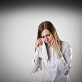 Sad and Unhappy woman in white is crying. Royalty Free Stock Photos