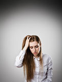 Sad and Unhappy woman in white Royalty Free Stock Images