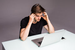 Sad unhappy young man with head ache of losed games. Gaming concept Royalty Free Stock Images