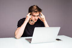 Sad unhappy young man with head ache of losed games. Gaming concept. Sad unhappy young man with head ache of losed games Royalty Free Stock Images