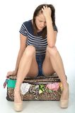 Sad Unhappy Young Woman Wearing Shorts Sitting on an Overflowing Stock Images