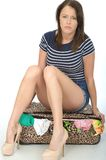 Sad Unhappy Young Woman Wearing Shorts Sitting on an Overflowing Royalty Free Stock Photo