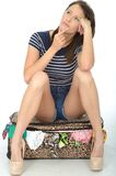 Sad Unhappy Young Woman Wearing Shorts Sitting on an Overflowing Stock Photography