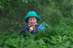 Sad, upset boy in the forest dark more often. Royalty Free Stock Photos